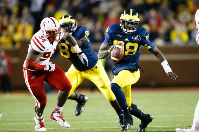 Nov 9, 2013; Ann Arbor, MI, USA; Michigan Wolverines quarterback Devin Gardner (98) runs the ball in the second half against the Nebraska Cornhuskers at Michigan Stadium. Nebraska won 17-13. Mandatory Credit: Rick Osentoski-USA TODAY Sports
