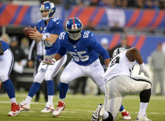Nov 10, 2013; East Rutherford, NJ, USA; New York Giants tackle Will Beatty (65) defends as quarterback Eli Manning (10) drops back to pass against the Oakland Raiders at MetLife Stadium. The Giants defeated the Raiders 24-20. Mandatory Credit: Kirby Lee-USA TODAY Sports