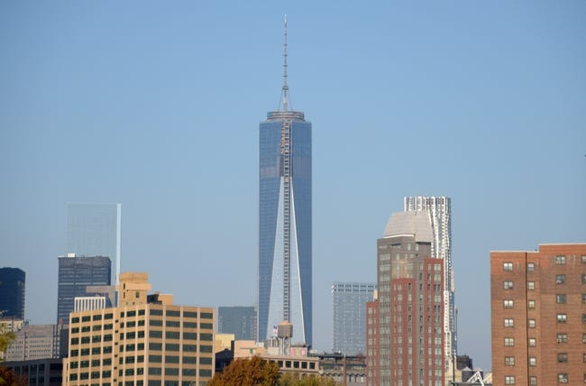 Nov 10, 2013; New York, NY, USA; General view of the Freedom Tower (One World Trade Center) and the Manhattan skyline. Mandatory Credit: Kirby Lee-USA TODAY Sports