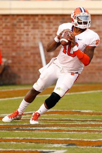 Nov 2, 2013; Charlottesville, VA, USA; Clemson Tigers quarterback Tajh Boyd (10) prepares to throw the ball against the Virginia Cavaliers at Scott Stadium. Mandatory Credit: Geoff Burke-USA TODAY Sports