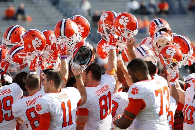 Nov 2, 2013; Charlottesville, VA, USA; Clemson Tigers players stand on the field during warm ups prior to the Tigers game against the Virginia Cavaliers at Scott Stadium. Mandatory Credit: Geoff Burke-USA TODAY Sports