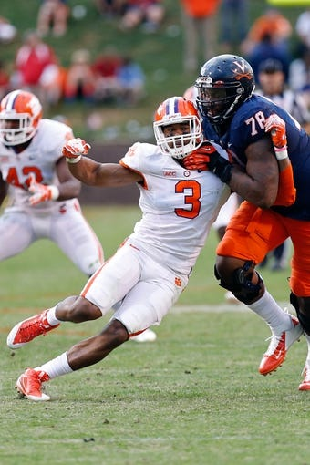 Nov 2, 2013; Charlottesville, VA, USA; Clemson Tigers defensive end Vic Beasley (3) is blocked by Virginia Cavaliers offensive tackle Morgan Moses (78) at Scott Stadium. Mandatory Credit: Geoff Burke-USA TODAY Sports