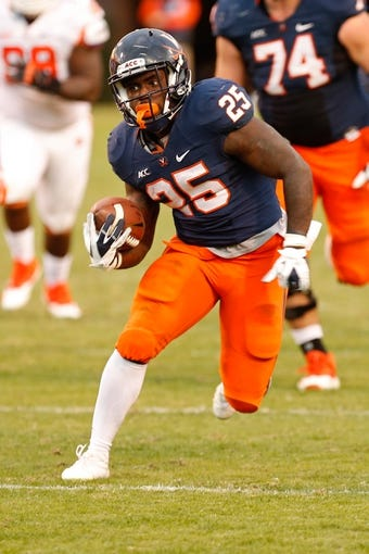 Nov 2, 2013; Charlottesville, VA, USA; Virginia Cavaliers running back Kevin Parks (25) carries the ball against the Clemson Tigers at Scott Stadium. Mandatory Credit: Geoff Burke-USA TODAY Sports