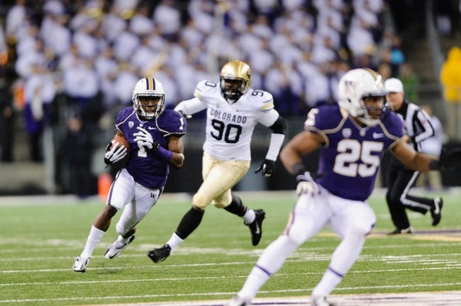 Nov 9, 2013; Seattle, WA, USA; Washington Huskies wide receiver John Ross (1) carries the ball against the Colorado Buffaloes during the game at Husky Stadium. Washington defeated Colorado 59-7. Mandatory Credit: Steven Bisig-USA TODAY Sports