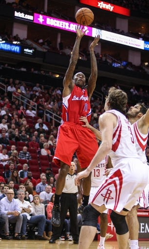 Nov 9, 2013; Houston, TX, USA; Los Angeles Clippers shooting guard Jamal Crawford (11) shoots during the third quarter against the Houston Rockets at Toyota Center. Mandatory Credit: Troy Taormina-USA TODAY Sports