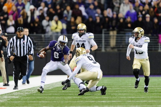 Nov 9, 2013; Seattle, WA, USA; Washington Huskies wide receiver Kevin Smith (8) tries to avoid the tackle by Colorado Buffaloes defensive back Tedric Thompson (9) during the game at Husky Stadium. Washington defeated Colorado 59-7. Mandatory Credit: Steven Bisig-USA TODAY Sports