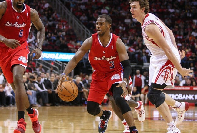 Nov 9, 2013; Houston, TX, USA; Los Angeles Clippers point guard Chris Paul (3) drives the ball during the third quarter against the Houston Rockets at Toyota Center. Mandatory Credit: Troy Taormina-USA TODAY Sports