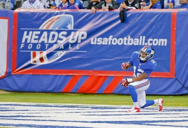 Nov 10, 2013; East Rutherford, NJ, USA;  New York Giants wide receiver Jerrel Jernigan (12) takes a knee in the end zone on Oakland Raiders kickoff during the first half at MetLife Stadium. Mandatory Credit: Jim O'Connor-USA TODAY Sports