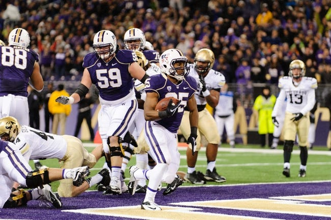 Nov 9, 2013; Seattle, WA, USA; Washington Huskies running back Bishop Sankey (25) scores a touchdown against the Colorado Buffaloes during the game at Husky Stadium. Washington defeated Colorado 59-7. Mandatory Credit: Steven Bisig-USA TODAY Sports