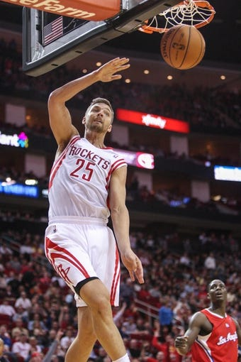 Nov 9, 2013; Houston, TX, USA; Houston Rockets small forward Chandler Parsons (25) dunks the ball during the second quarter against the Los Angeles Clippers at Toyota Center. Mandatory Credit: Troy Taormina-USA TODAY Sports