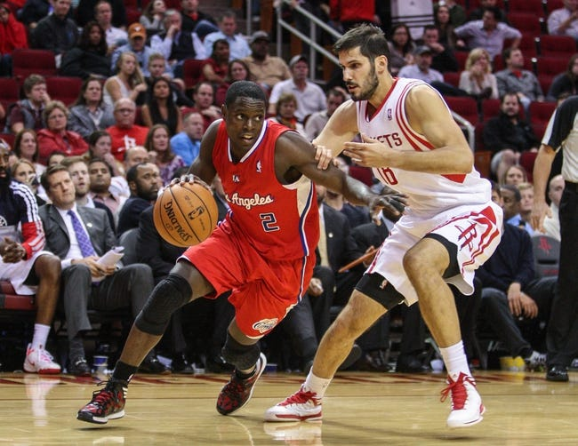 Nov 9, 2013; Houston, TX, USA; Los Angeles Clippers point guard Darren Collison (2) drives the ball during the fourth quarter as Houston Rockets small forward Omri Casspi (18) defends at Toyota Center. Mandatory Credit: Troy Taormina-USA TODAY Sports