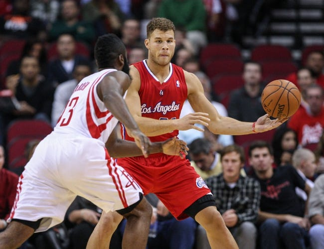 Nov 9, 2013; Houston, TX, USA; Los Angeles Clippers power forward Blake Griffin (32) controls the ball during the first quarter as Houston Rockets shooting guard James Harden (13) defends at Toyota Center. Mandatory Credit: Troy Taormina-USA TODAY Sports