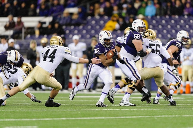 Nov 9, 2013; Seattle, WA, USA; Washington Huskies running back Bishop Sankey (25) carries the ball past Colorado Buffaloes linebacker Addison Gillam (44) during the game at Husky Stadium. Washington defeated Colorado 59-7. Mandatory Credit: Steven Bisig-USA TODAY Sports