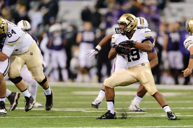 Nov 9, 2013; Seattle, WA, USA; Colorado Buffaloes running back Michael Adkins II (19) carries the ball against the Washington Huskies during the game at Husky Stadium. Washington defeated Colorado 59-7. Mandatory Credit: Steven Bisig-USA TODAY Sports