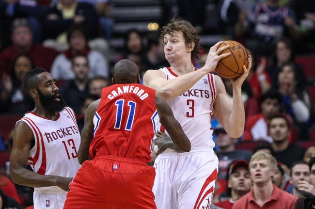 Nov 9, 2013; Houston, TX, USA; Houston Rockets center Omer Asik (3) controls the ball during the first quarter as Los Angeles Clippers shooting guard Jamal Crawford (11) defends at Toyota Center. Mandatory Credit: Troy Taormina-USA TODAY Sports