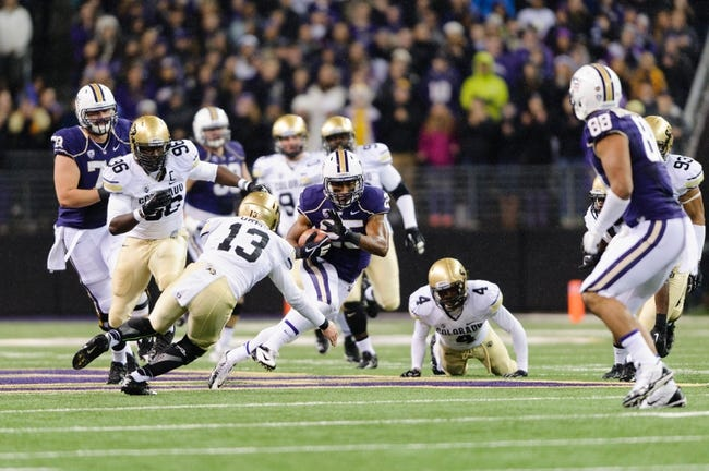 Nov 9, 2013; Seattle, WA, USA; Washington Huskies running back Bishop Sankey (25) carries the ball while Colorado Buffaloes defensive back Parker Orms (13) tries to tackle during the game at Husky Stadium. Washington defeated Colorado 59-7. Mandatory Credit: Steven Bisig-USA TODAY Sports