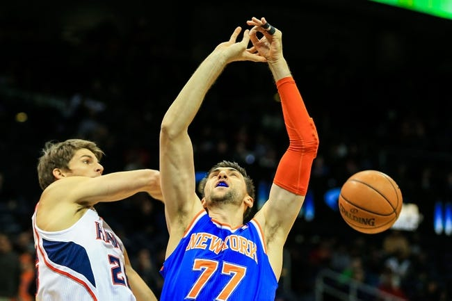 Nov 13, 2013; Atlanta, GA, USA; Atlanta Hawks shooting guard Kyle Korver (26) slaps the ball away from New York Knicks power forward Andrea Bargnani (77) in the first quarter at Philips Arena. Mandatory Credit: Daniel Shirey-USA TODAY Sports