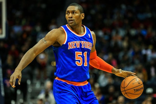 Nov 13, 2013; Atlanta, GA, USA; New York Knicks small forward Metta World Peace (51) dribbles down the court in the first half against the Atlanta Hawks at Philips Arena. Mandatory Credit: Daniel Shirey-USA TODAY Sports
