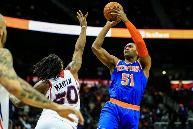 Nov 13, 2013; Atlanta, GA, USA; New York Knicks small forward Metta World Peace (51) shoots a basket over Atlanta Hawks small forward Cartier Martin (20) in the first half at Philips Arena. Mandatory Credit: Daniel Shirey-USA TODAY Sports