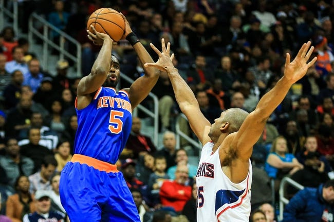 Nov 13, 2013; Atlanta, GA, USA; New York Knicks shooting guard Tim Hardaway Jr. (5) shoots a basket over Atlanta Hawks center Al Horford (15) in the first half at Philips Arena. Mandatory Credit: Daniel Shirey-USA TODAY Sports