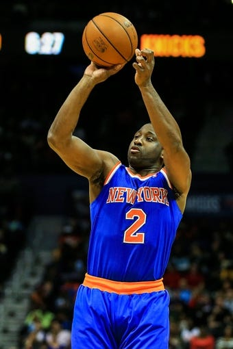 Nov 13, 2013; Atlanta, GA, USA; New York Knicks point guard Raymond Felton (2) shoots a three in the first half against the Atlanta Hawks at Philips Arena. Mandatory Credit: Daniel Shirey-USA TODAY Sports