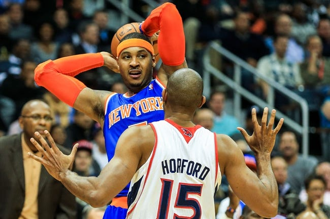 Nov 13, 2013; Atlanta, GA, USA; New York Knicks small forward Carmelo Anthony (7) keeps the ball away from Atlanta Hawks center Al Horford (15) in the first half at Philips Arena. Mandatory Credit: Daniel Shirey-USA TODAY Sports