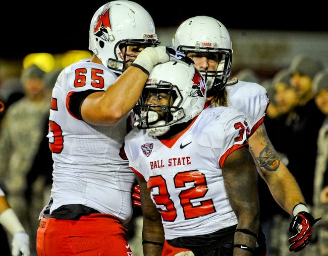 Nov 13, 2013; DeKalb, IL, USA; Ball State Huskies running back Jahwan Edwards (32) celebrates his touchdown with offensive guard Jalen Schlachter (65) against Northern Illinois Cardinals during the 2nd quarter at Huskie Stadium. Mandatory Credit: Matt Marton-USA TODAY Sports