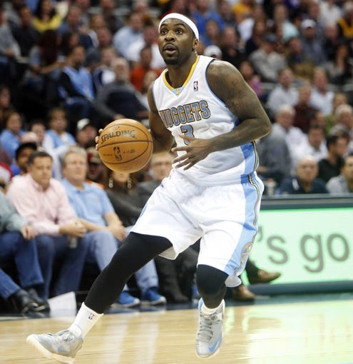 Nov 13, 2013; Denver, CO, USA; Denver Nuggets guard Ty Lawson (3) drives to the basket during the first half against the Los Angeles Lakers at Pepsi Center. Mandatory Credit: Chris Humphreys-USA TODAY Sports