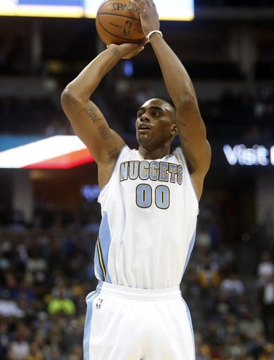 Nov 13, 2013; Denver, CO, USA; Denver Nuggets forward Darrell Arthur (00) shoots the ball during the first quarter against the  Los Angeles Lakers at Pepsi Center. Mandatory Credit: Chris Humphreys-USA TODAY Sports
