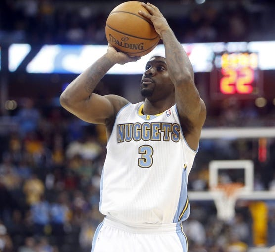 Nov 13, 2013; Denver, CO, USA; Denver Nuggets guard Ty Lawson (3) shoots the ball during the first quarter against the Los Angeles Lakers at Pepsi Center. Mandatory Credit: Chris Humphreys-USA TODAY Sports