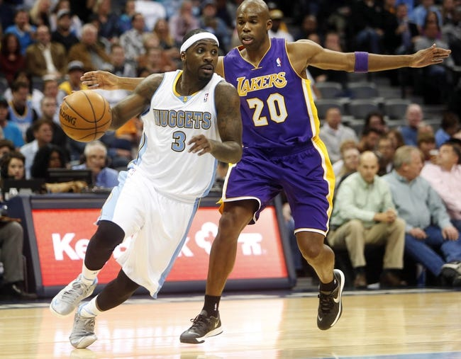 Nov 13, 2013; Denver, CO, USA; Denver Nuggets guard Ty Lawson (3) drives to the basket against Los Angeles Lakers guard Jodie Meeks (20) during the first half against at Pepsi Center. Mandatory Credit: Chris Humphreys-USA TODAY Sports