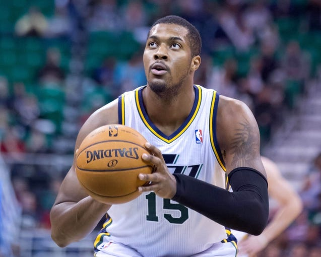 Nov 13, 2013; Salt Lake City, UT, USA; Utah Jazz power forward Derrick Favors (15) shoots a free throw during the first half against the New Orleans Pelicans at EnergySolutions Arena. Mandatory Credit: Russ Isabella-USA TODAY Sports