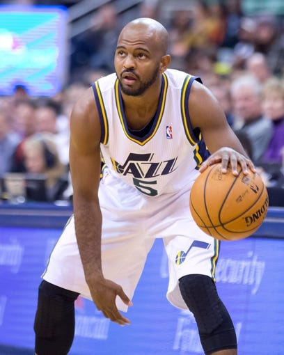 Nov 13, 2013; Salt Lake City, UT, USA; Utah Jazz point guard John Lucas III (5) controls the ball during the first half against the New Orleans Pelicans at EnergySolutions Arena. Mandatory Credit: Russ Isabella-USA TODAY Sports