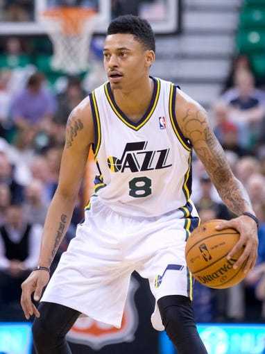 Nov 13, 2013; Salt Lake City, UT, USA; Utah Jazz guard Diante Garrett (8) controls the ball during the first half against the New Orleans Pelicans at EnergySolutions Arena. Mandatory Credit: Russ Isabella-USA TODAY Sports
