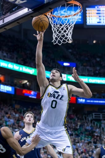 Nov 13, 2013; Salt Lake City, UT, USA; Utah Jazz center Enes Kanter (0) shoots during the first half against the New Orleans Pelicans at EnergySolutions Arena. Mandatory Credit: Russ Isabella-USA TODAY Sports
