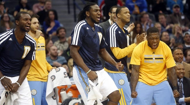 Nov 13, 2013; Denver, CO, USA; Members of the Denver Nuggets react from the bench after a play during the first quarter against the Los Angeles Lakers at Pepsi Center. Mandatory Credit: Chris Humphreys-USA TODAY Sports
