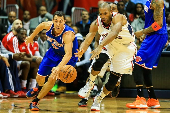 Nov 13, 2013; Atlanta, GA, USA; New York Knicks point guard Pablo Prigioni (9) steals the ball from Atlanta Hawks center Al Horford (15) in the second half at Philips Arena. The Knicks won 95-91. Mandatory Credit: Daniel Shirey-USA TODAY Sports