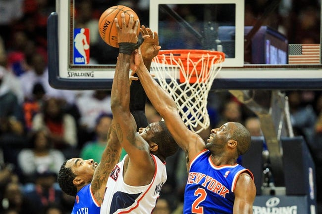 Nov 13, 2013; Atlanta, GA, USA; Atlanta Hawks point guard Shelvin Mack (8) goes up for a rebound with New York Knicks shooting guard J.R. Smith (8) and point guard Raymond Felton (2) in the second half at Philips Arena. The Knicks won 95-91. Mandatory Credit: Daniel Shirey-USA TODAY Sports