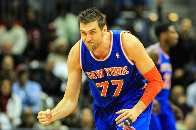 Nov 13, 2013; Atlanta, GA, USA; New York Knicks power forward Andrea Bargnani (77) celebrates a three in the second half against the Atlanta Hawks at Philips Arena. The Knicks won 95-91. Mandatory Credit: Daniel Shirey-USA TODAY Sports