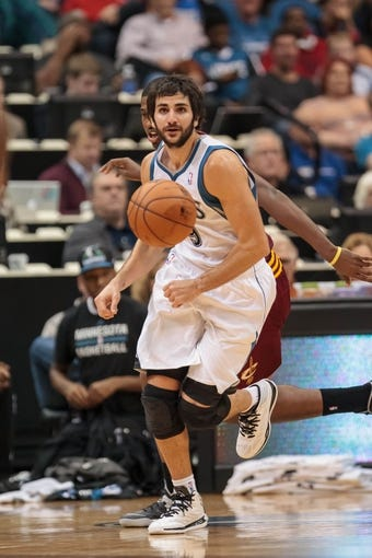 Nov 13, 2013; Minneapolis, MN, USA; Minnesota Timberwolves point guard Ricky Rubio (9) chases the ball in the third quarter against the Cleveland Cavaliers at Target Center. The Minnesota Timberwolves win 124-95. Mandatory Credit: Brad Rempel-USA TODAY Sports.