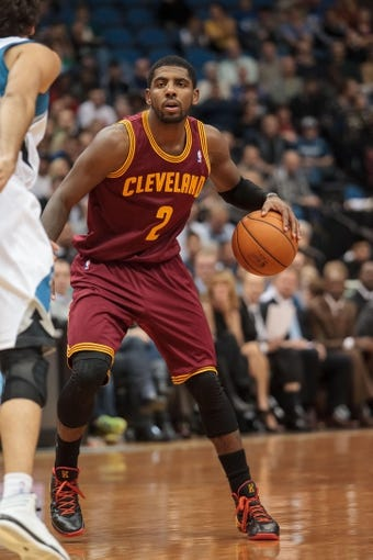 Nov 13, 2013; Minneapolis, MN, USA; Cleveland Cavaliers point guard Kyrie Irving (2) dribbles in the third quarter against the Minnesota Timberwolves at Target Center. The Minnesota Timberwolves win 124-95. Mandatory Credit: Brad Rempel-USA TODAY Sports.