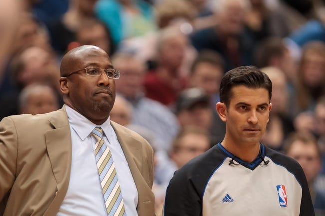 Nov 13, 2013; Minneapolis, MN, USA; Cleveland Cavaliers head coach Mike Brown and referee Zach Zarba in the third quarter against the Minnesota Timberwolves at Target Center. The Minnesota Timberwolves win 124-95. Mandatory Credit: Brad Rempel-USA TODAY Sports.