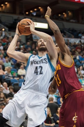 Nov 13, 2013; Minneapolis, MN, USA; Minnesota Timberwolves power forward Kevin Love (42) shoots in the third quarter against the Cleveland Cavaliers at Target Center. The Minnesota Timberwolves win 124-95. Mandatory Credit: Brad Rempel-USA TODAY Sports.