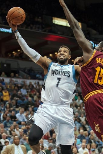 Nov 13, 2013; Minneapolis, MN, USA; Minnesota Timberwolves power forward Derrick Williams (7) shoots in the fourth quarter against the Cleveland Cavaliers at Target Center. Mandatory Credit: Brad Rempel-USA TODAY Sports. The Minnesota Timberwolves win 124-95.