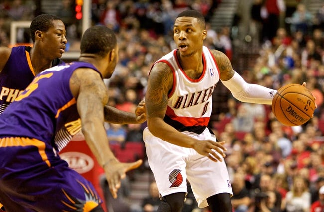 Nov 13, 2013; Portland, OR, USA; Portland Trail Blazers point guard Damian Lillard (0) looks to pass against the Phoenix Suns at the Moda Center. Mandatory Credit: Craig Mitchelldyer-USA TODAY Sports