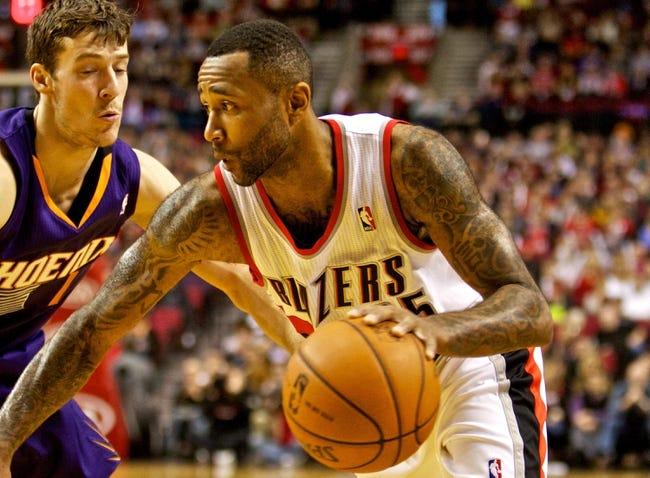 Nov 13, 2013; Portland, OR, USA; Portland Trail Blazers point guard Mo Williams (25) drives past Phoenix Suns shooting guard Goran Dragic (1) at the Moda Center. Mandatory Credit: Craig Mitchelldyer-USA TODAY Sports