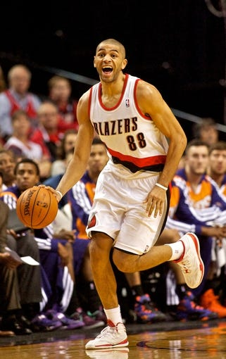 Nov 13, 2013; Portland, OR, USA; Portland Trail Blazers small forward Nicolas Batum (88) calls out a play against the Phoenix Suns at the Moda Center. Mandatory Credit: Craig Mitchelldyer-USA TODAY Sports