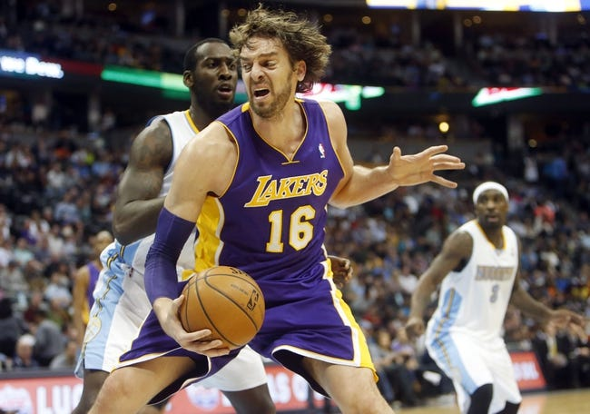 Nov 13, 2013; Denver, CO, USA;  Los Angeles Lakers forward Pau Gasol (16) during the second half against the Denver Nuggets at Pepsi Center.  The Nuggets won 111-99.  Mandatory Credit: Chris Humphreys-USA TODAY Sports