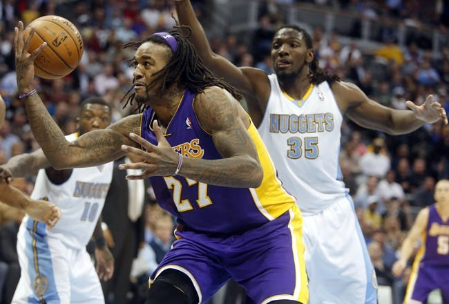 Nov 13, 2013; Denver, CO, USA;  Los Angeles Lakers forward Jordan Hill (27) recovers a loose ball during the second half against the   Denver Nuggets at Pepsi Center.  The Nuggets won 111-99.  Mandatory Credit: Chris Humphreys-USA TODAY Sports
