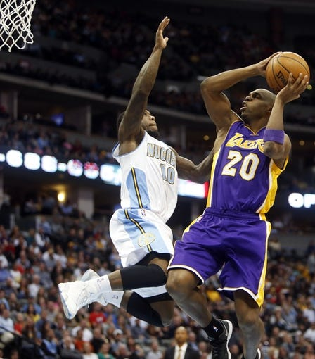 Nov 13, 2013; Denver, CO, USA;  Los Angeles Lakers guard Jodie Meeks (20) is fouled by Denver Nuggets guard Nate Robinson (10) during the second half at Pepsi Center.  The Nuggets won 111-99.  Mandatory Credit: Chris Humphreys-USA TODAY Sports